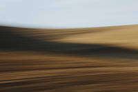 Blurred motion abstract of wheat field and farmland