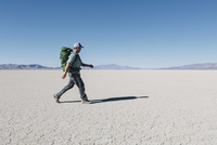 Male backpacker hiking in vast desert, Black Rock Desert, Nevada