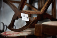 Antique furniture, a cradle rocker with a price label.