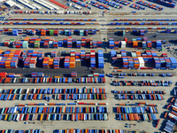 Aerial view of the container port at San Pedro in Los Angeles, with containers awaiting loading. A commercial freight dockyard.