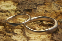 Two gold rings shaped, smooth and different sizes Jewellery.