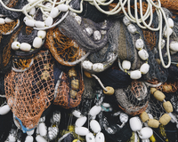Close up of a pile of tangled up commercial fishing nets with floats attached. 11093014605| 写真素材・ストックフォト・画像・イラスト素材|アマナイメージズ