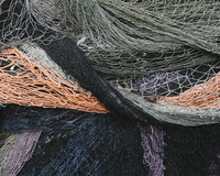 Close up of a pile of tangled up commercial fishing nets. 11093014612| 写真素材・ストックフォト・画像・イラスト素材|アマナイメージズ