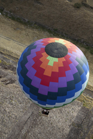 A hot air balloon in flight seen from above.