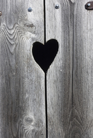 typical little heart shaped window of wooden door