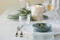 Holly and place setting on Christmas table
