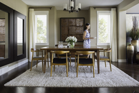 Woman setting table in dining room
