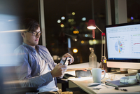Businessman with digital tablet working late in office