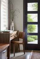 Wood desk and chair in sunny elegant corner