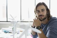 Portrait confident engineer with wind turbine models