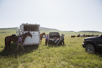 Female ranchers with picnic truck bed remote field