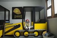 Boy fireman costume using digital tablet bedroom