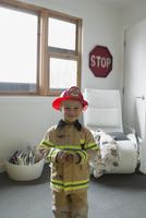 Portrait cute boy in fireman costume