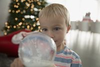 Wide-eyed boy looking at snow globe