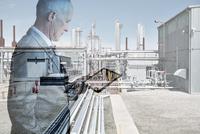 Digital composite businessman using digital tablet at factory 11096017058| 写真素材・ストックフォト・画像・イラスト素材|アマナイメージズ