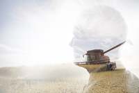 Digital composite pensive businessman watching combine harvester