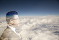 Digital composite businessman with head in clouds