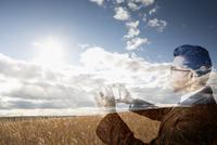 Digital composite businessman photographing golden wheat field 11096017067| 写真素材・ストックフォト・画像・イラスト素材|アマナイメージズ