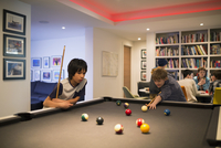 Boys playing pool at pool table