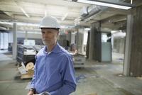 Portrait confident architect in hard-hat construction site