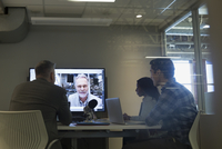 Business people in video conference meeting
