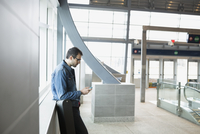 Man checking cell phone at train station