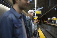 Senior man waiting on subway station platform