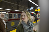 Smiling woman on subway station platform