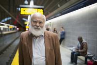 Portrait senior man with beard subway station platform