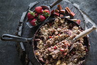 Still life fresh skillet strawberry granola