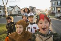 Portrait enthusiastic kids in Halloween costumes