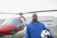 Portrait confident helicopter pilot with helmet