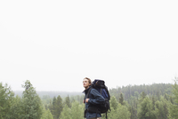mid-adult man backpacking in the woods