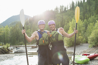 portrait of two kayakers posing with paddles