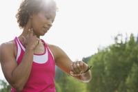 mid-adult runner checking her pulse
