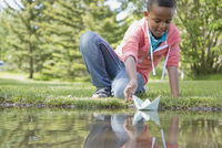 elementary student sailing paper boat