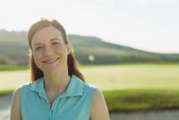 portrait of pretty, mid-adult female golfer