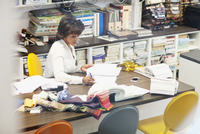 designer doing inventory of stock fabric
