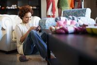 knitting at the yarn store