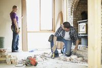mid adult couple renovating together