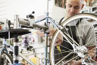 man repairing bike at bike shop