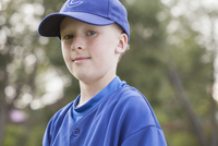 Portrait of serious young baseball player in uniform.