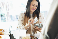 woman paying for purchase