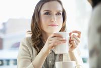 stylish young women having coffee