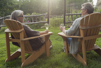 senior couple relaxing with wine outdoors