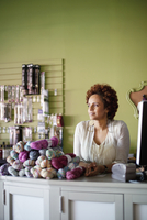 business owner of yarn shop at counter