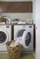 Contemporary laundry room with basket of clean clothes.