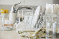 Modern white dishes drying in rack.