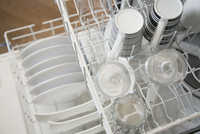 View from above of clean dishes in dishwasher.