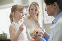 young patient accepting a lollipop